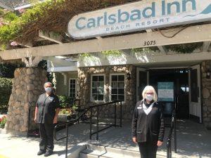 Gloria Perez. Karen Hansen. Carlsbad Inn entrance.